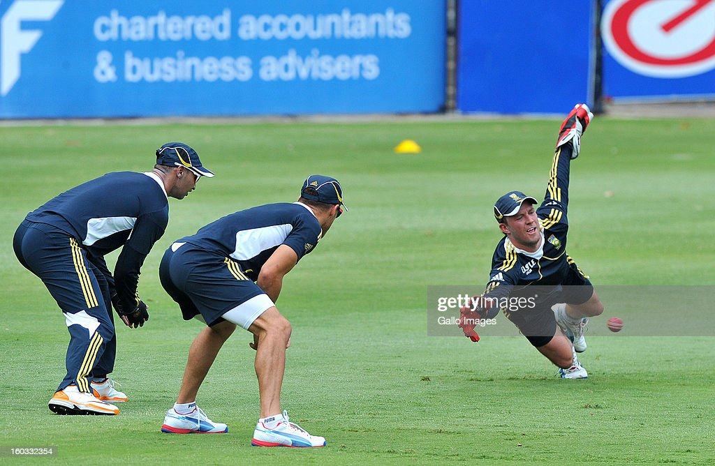 AB de Villiers dives for a catch during a South Africa National cricket team training session ahead of Graeme Smith's 100th Test as captain at Sandton City on January 29, 2013 in Johannesburg, South Africa.