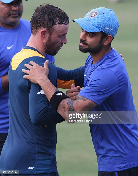 AB de Villiers of South Africa and Virat Kohli of India sharing a light moment during the training session before the 2nd T20 match against South...