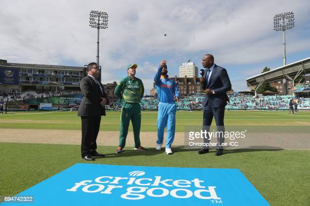 AB de Villiers of South Africa and Virat Kohli of India toss the coin before kick off during the ICC Champions Trophy Group B match between India and...