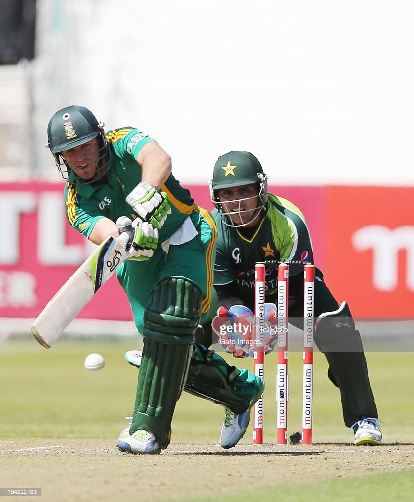 AB de Villiers of South Africa bats as wicketkeeper <a gi-track='captionPersonalityLinkClicked' href=/galleries/search?phrase=Kamran+Akmal&family=editorial&specificpeople=221679 ng-click='$event.stopPropagation()'>Kamran Akmal</a> looks on during the 4th Momentum One Day International match between South Africa and Pakistan at Sahara Stadium Kingsmead on March 21, 2013 in Durban, South Africa.