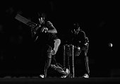 AB de Villiers of South Africa bats as wicketkeeper Matthew Wade of Australia looks on during game one of the men's one day international series...