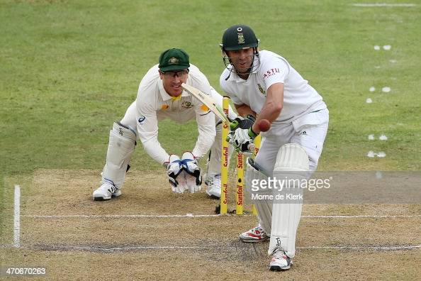 AB de Villiers of South Africa bats in front of Brad Haddin of Australia during day one of the Second Test match between South Africa and Australia...