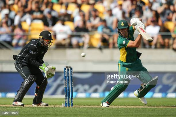 AB de Villiers of South Africa bats while Tom Latham of New Zealand looks on during game three of the One Day International series between New...