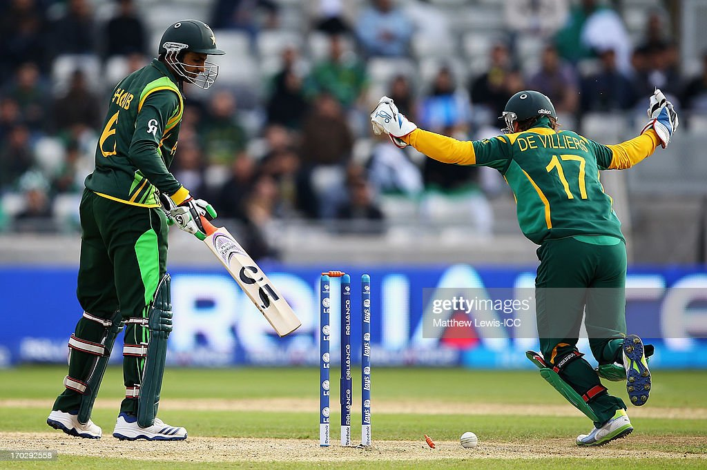 AB de Villiers of South Africa celebrates, as <a gi-track='captionPersonalityLinkClicked' href=/galleries/search?phrase=Shoaib+Malik&family=editorial&specificpeople=221455 ng-click='$event.stopPropagation()'>Shoaib Malik</a> of Pakistan is bowled by JP Duminey of South Africa during the ICC Champions Trophy Group B match between Pakistan and South Africa at Edgbaston on June 10, 2013 in Birmingham, England.