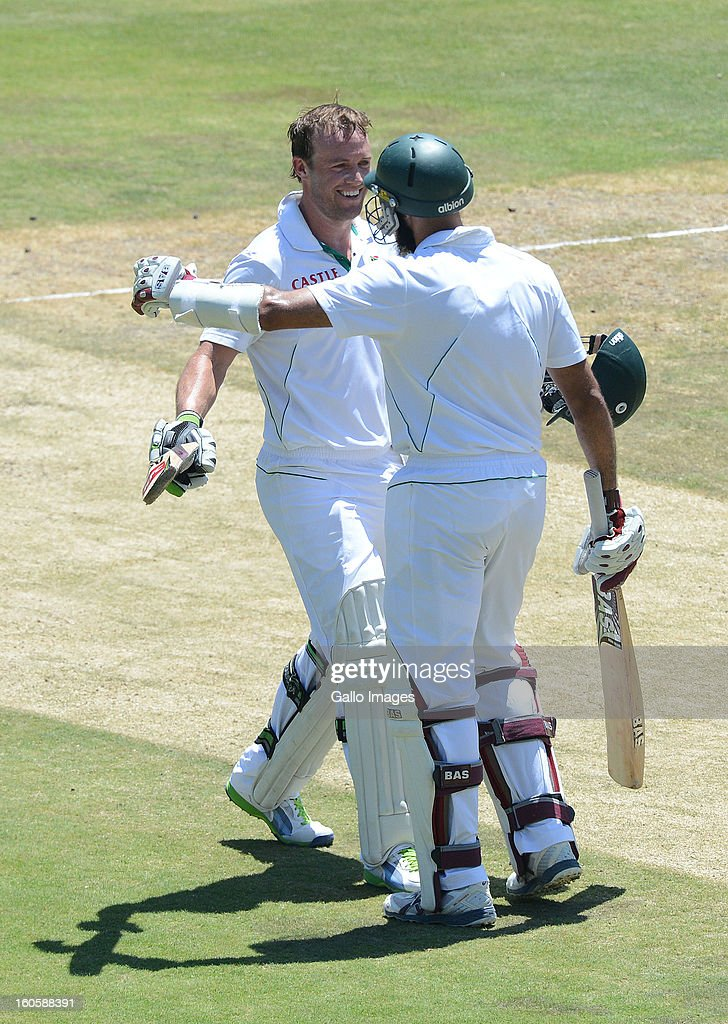 AB de Villiers of South Africa celebrates his 100 with team-mate <a gi-track='captionPersonalityLinkClicked' href=/galleries/search?phrase=Hashim+Amla&family=editorial&specificpeople=647392 ng-click='$event.stopPropagation()'>Hashim Amla</a> during day 3 of the 1st Test match between South Africa and Pakistan at Bidvest Wanderers Stadium on February 03, 2013 in Johannesburg, South Africa.