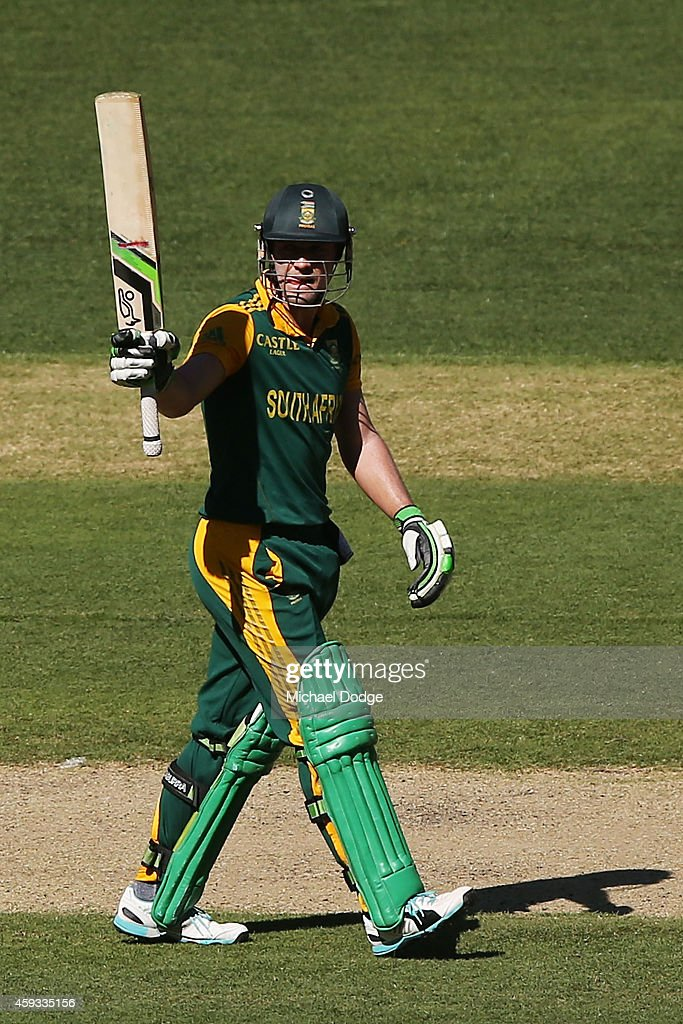 AB de Villiers of South Africa celebrates his half century during game four of the One Day International series between Australia and South Africa at Melbourne Cricket Ground on November 21, 2014 in Melbourne, Australia.