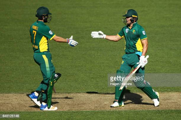AB de Villiers of South Africa celebrates his half century with teammate Wayne Parnell during game three of the One Day International series between...