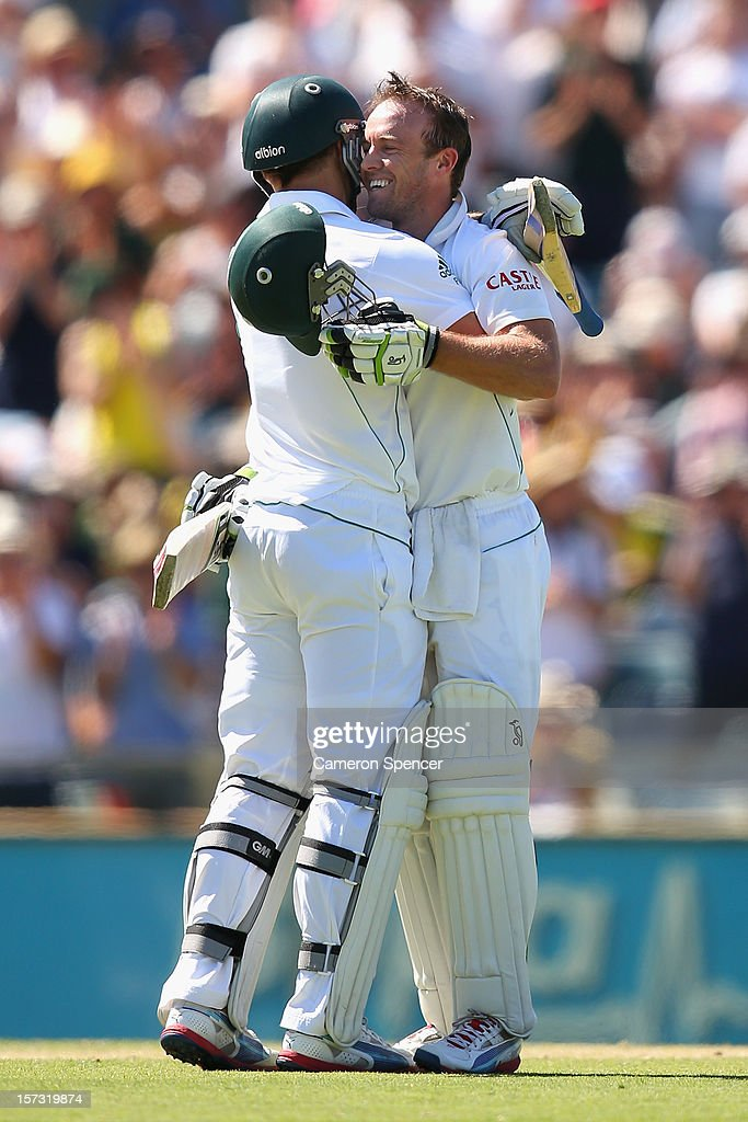 AB de Villiers of South Africa (R) celebrates scoring a century with team mate Faf Du Plessis during day three of the Third Test Match between Australia and South Africa at the WACA on December 2, 2012 in Perth, Australia.
