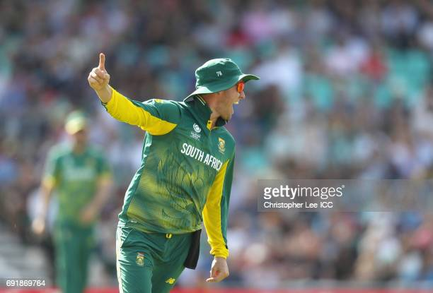 De Villiers of South Africa celebrates taking the wicket Dinesh Chandimal of Sri Lanka during the ICC Champions Trophy Group B match between Sri...