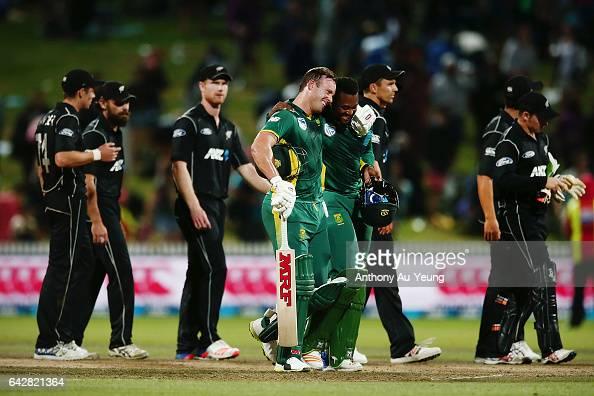 AB de Villiers of South Africa celebrates with teammate Andile Phehlukwayo after winning the First One Day International match between New Zealand...