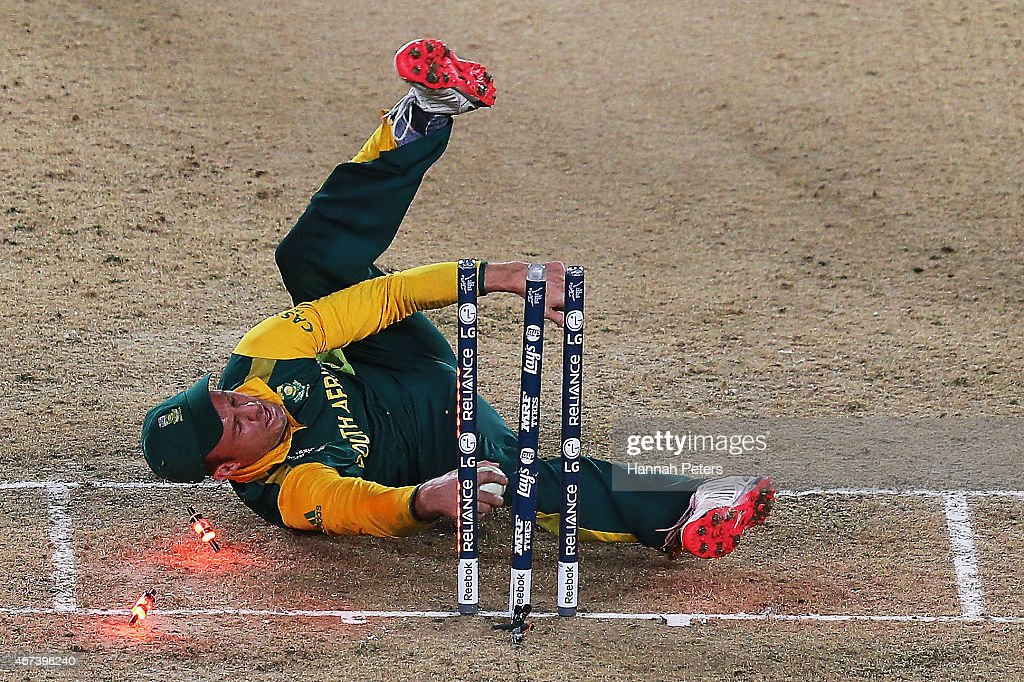 AB de Villiers of South Africa falls over the stumps during the 2015 Cricket World Cup Semi Final match between New Zealand and South Africa at Eden Park on March 24, 2015 in Auckland, New Zealand.