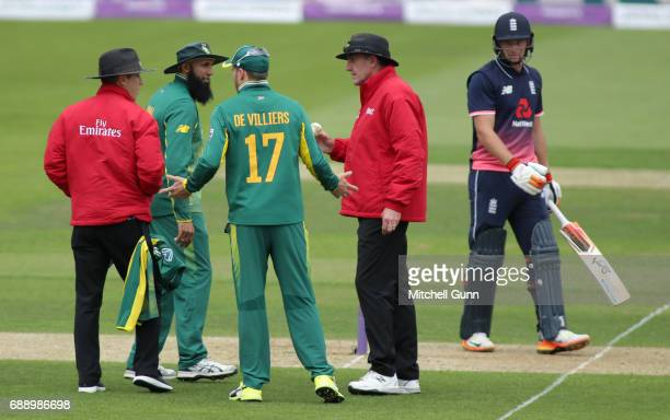 AB de Villiers of South Africa in consultation with umpires Rob Bailey and Chris Gaffaney about the condition of the match ball during the 2nd Royal...