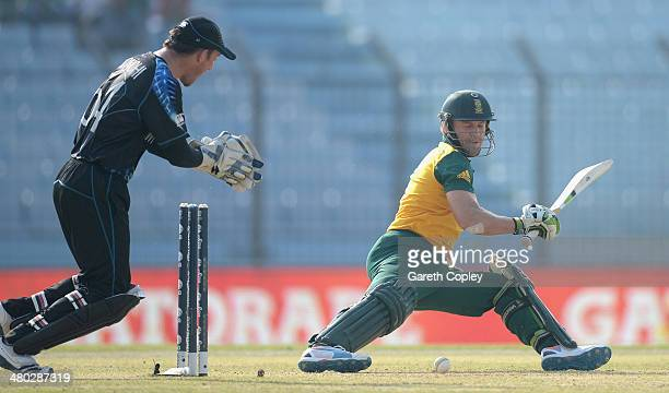 AB de Villiers of South Africa is bowled by Nathan McCullum of New Zealand during the ICC World Twenty20 Bangladesh 2014 Group 1 match between New...