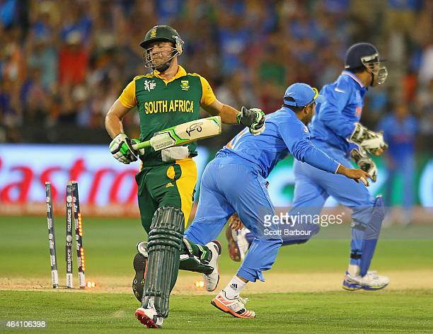 AB de Villiers of South Africa is run out as MS Dhoni of India celebrates the 2015 ICC Cricket World Cup match between South Africa and India at...