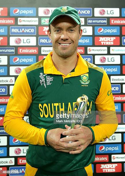 AB de Villiers of South Africa poses with player of match during the 2015 ICC Cricket World Cup match between South Africa and the West Indies at...