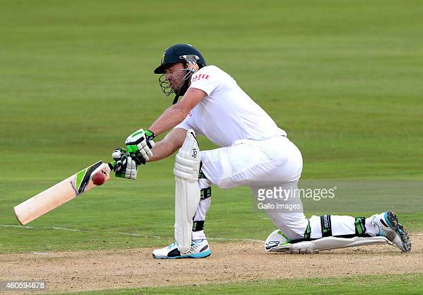 AB de Villiers of South Africa sweeps during day 1 of the 1st Test match between South Africa and West Indies at SuperSport Park on December 17 2014...