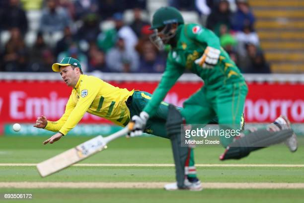 De Villiers of South Africa throws at the stumps as Babar Azam of Pakistan makes his ground during the ICC Champions Trophy match between Pakistan...