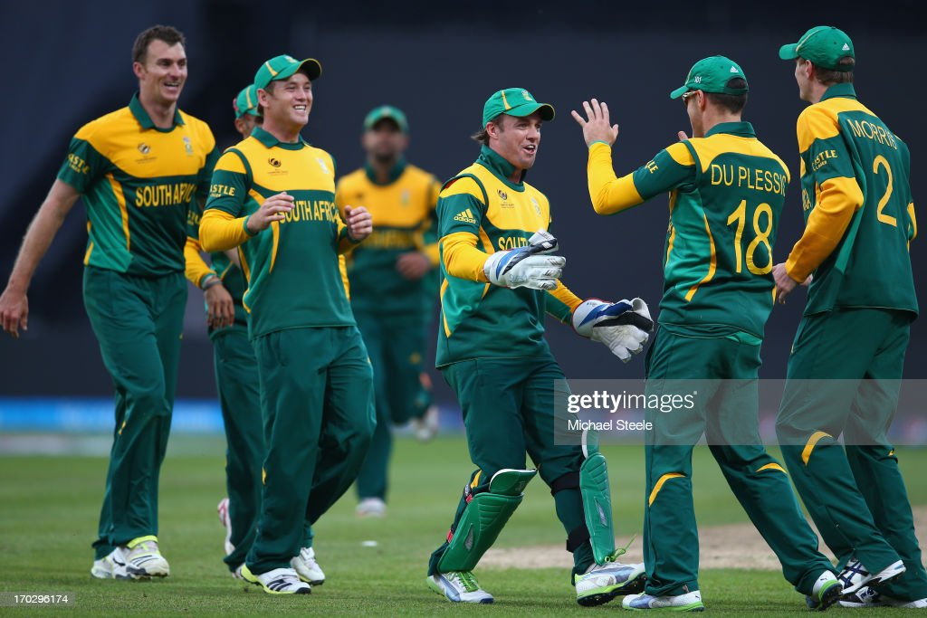 AB de Villiers (C) the captain of South Africa leads the celebrations after Faf Du Plessis (2R) caught Kamran Akmal of Pakistan during the ICC Champions Trophy Group B match between Pakistan and South Africa at Edgbaston on June 10, 2013 in Birmingham, England.