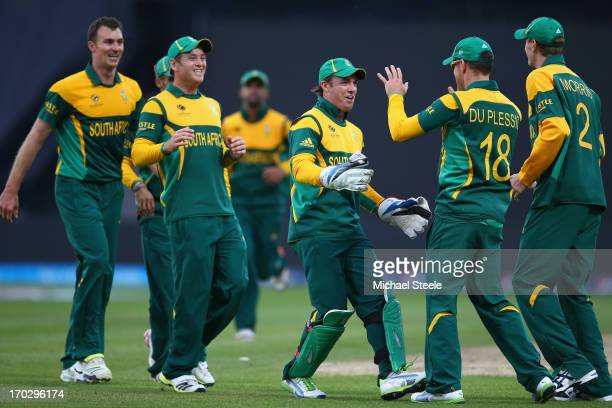 AB de Villiers the captain of South Africa leads the celebrations after Faf Du Plessis caught Kamran Akmal of Pakistan during the ICC Champions...