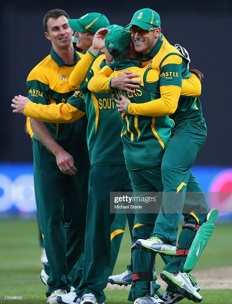 AB de Villiers the captain of South Africa lifts Faf Du Plessis (R) off his feet after catching Kamran Akmal of Pakistan during the ICC Champions Trophy Group B match between Pakistan and South Africa at Edgbaston on June 10, 2013 in Birmingham, England.