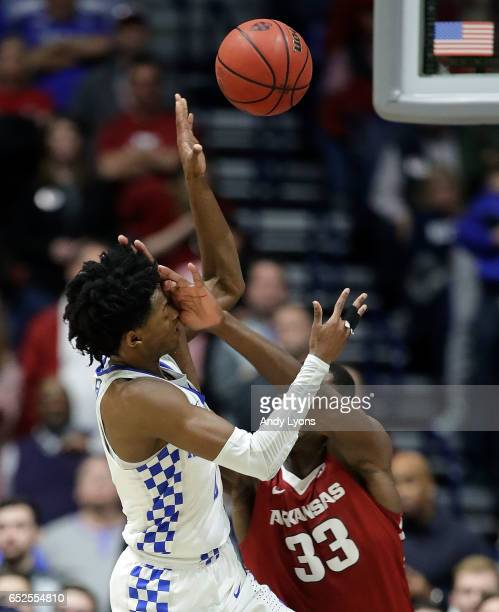 De'Aaron Fox of the Kentucky Wildcats draws a flagrant foul from Moses Kingsley of the Arkansas Razorbacks during the championship game at the 2017...