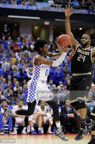 De'Aaron Fox of the Kentucky Wildcats passes against Shaquille Morris of the Wichita State Shockers in the second half during the second round of the...