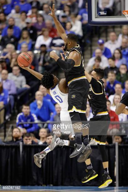 De'Aaron Fox of the Kentucky Wildcats shoots against Shaquille Morris of the Wichita State Shockers in the first half during the second round of the...