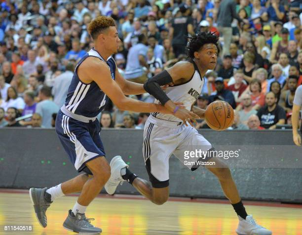 De'Aaron Fox of the Sacramento Kings dribbles against Wade Baldwin IV of the Memphis Grizzlies during the 2017 NBA Summer League game at the Cox...