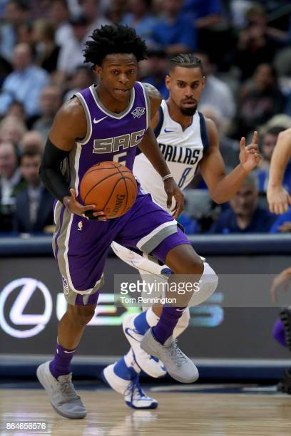 De'Aaron Fox of the Sacramento Kings dribbles the ball down court against Gian Clavell of the Dallas Mavericks at American Airlines Center on October...