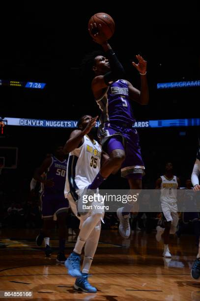 De'Aaron Fox of the Sacramento Kings drives to the basket against the Denver Nuggets on October 21 2017 at the Pepsi Center in Denver Colorado NOTE...
