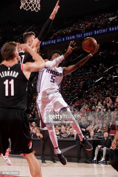 De'Aaron Fox of the Sacramento Kings goes to the basket against the Portland Trail Blazers on November 18 2017 at the Moda Center in Portland Oregon...