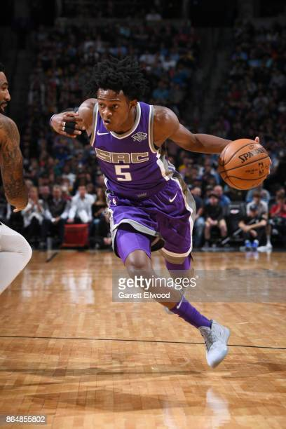 De'Aaron Fox of the Sacramento Kings handles the ball against the Denver Nuggets on October 21 2017 at the Pepsi Center in Denver Colorado NOTE TO...