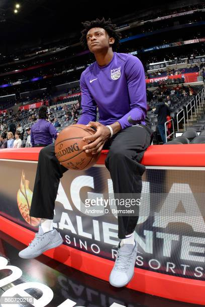 De'Aaron Fox of the Sacramento Kings looks on before the game against the LA Clippers on October 12 2017 at STAPLES Center in Los Angeles California...