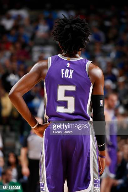 De'Aaron Fox of the Sacramento Kings looks on during the game against the Dallas Mavericks on October 20 2017 at the American Airlines Center in...