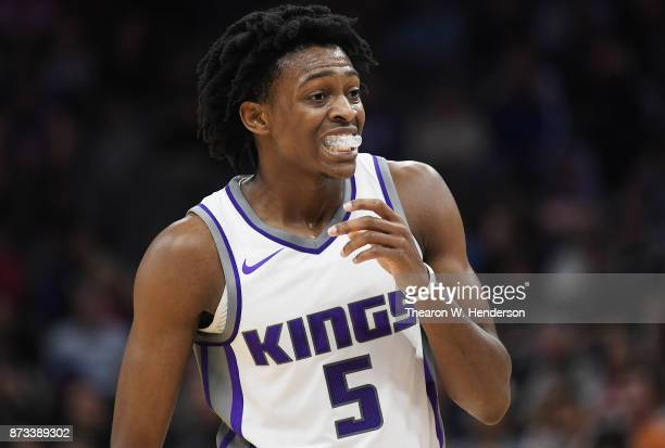 De'Aaron Fox of the Sacramento Kings looks on while there's a break in the action against the Philadelphia 76ers during an NBA basketball game at...