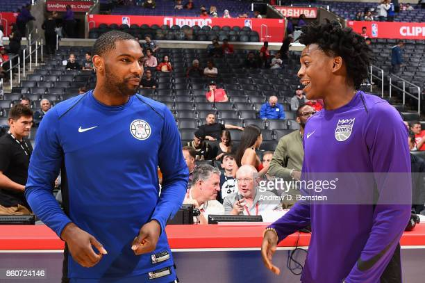 De'Aaron Fox of the Sacramento Kings talks to Sindarius Thornwell of the LA Clippers before the game on October 12 2017 at STAPLES Center in Los...