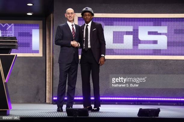 De'Aaron Fox shakes hands with NBA Commissioner Adam Silver after being selected number five overall by the Sacramento Kings during the 2017 NBA...