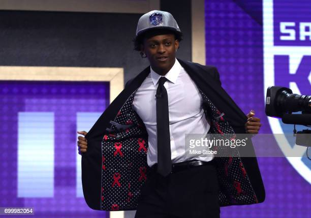 De'Aaron Fox shows his jacket linin on stage after being drafted fifth overall by the Sacramento Kings during the first round of the 2017 NBA Draft...