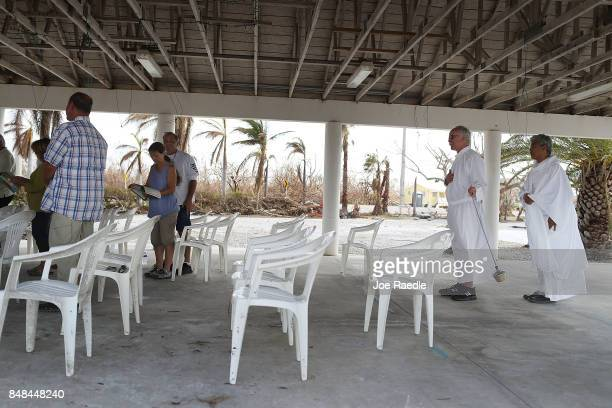 Deacon Richard Turcotte and Rev Jets Medina prepare to lead a mass for their congregation of St Peter Catholic Church under a pavillion after their...