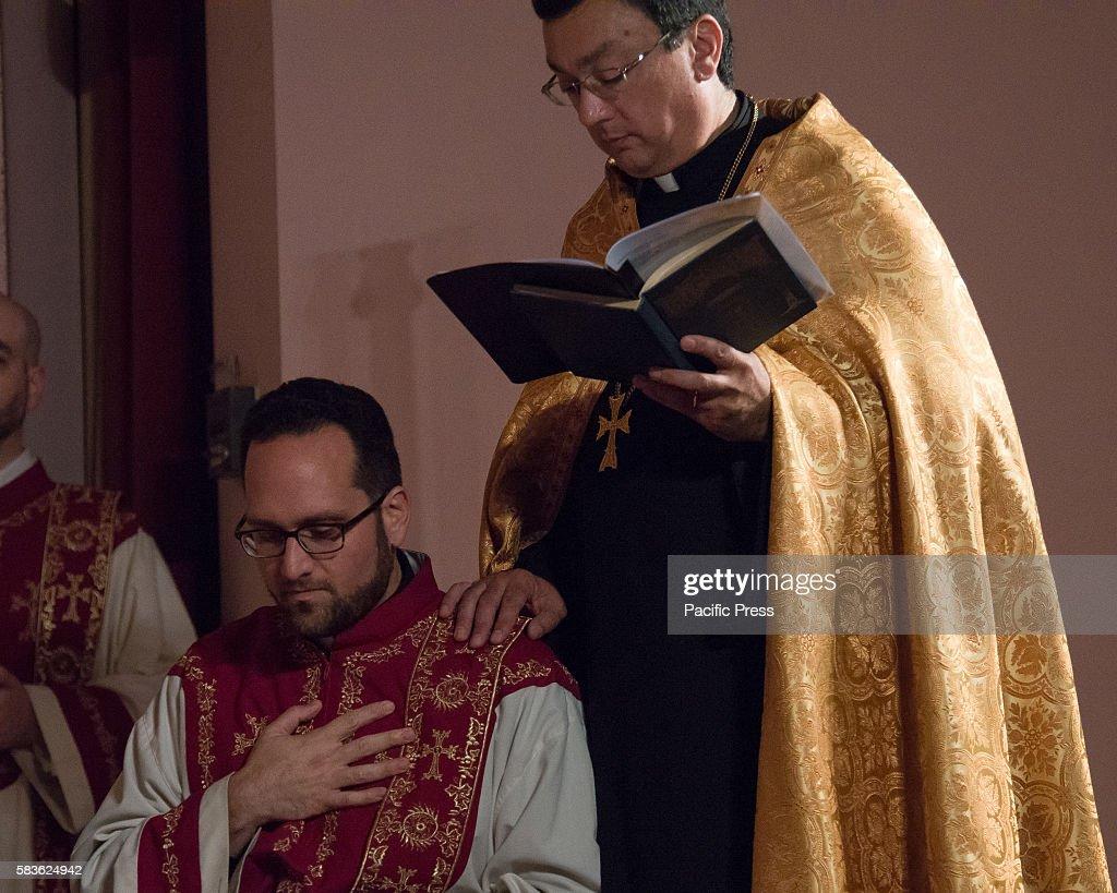 Deacon Saro Kalayjian kneels next to his clerical sponsor Archbishop Khajag Barsamian Prelate of the Eastern Diocese of the Armenian Apostolic Church...