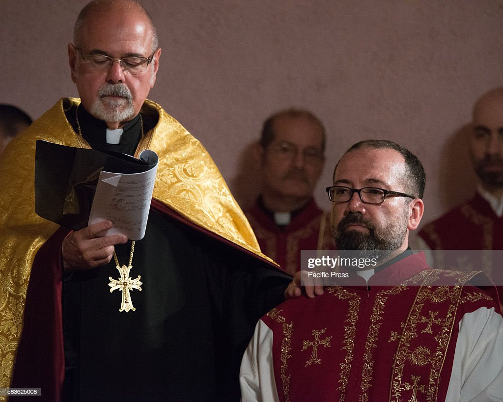 Deacon Vahe Bagdasarian kneels next to his clerical sponsor Archbishop Khajag Barsamian Prelate of the Eastern Diocese of the Armenian Apostolic...