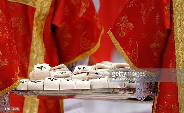 Deacons carries the Palliums as Pope Benedict XVI celebrates the Mass and imposition of the Pallium on new metropolitan archbishops during the feast...