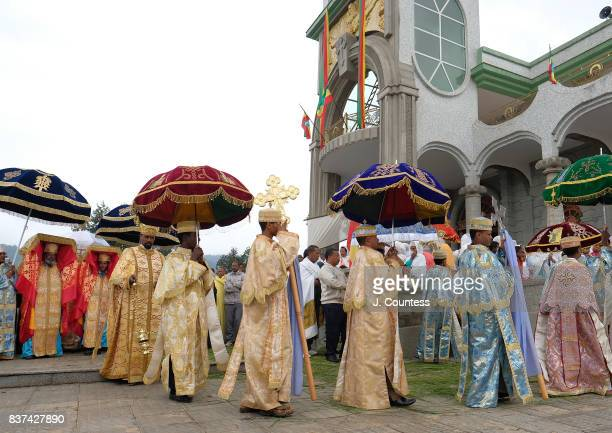 Deacons walk ahead of Priests carrying the Tabot a representation of the Ark of the Covenant as they lead followers of the Ethiopian Orthodox...