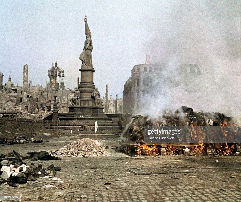 Dead bodies are burned at the Altmarkt near the Victory Monument (Germaniadenkmal). 25th February 1945.In four raids between February 13th and 15th bombers of the British Royal Air Force (RAF) and the United States Army Air Forces dropped more than 3,900 tons of high - explosive bombs and incendiary devices. At least 22,000 people were killed in the resulting firestorm. Dresden, Germany.