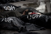 Dead bodies are lined up at a makeshift morgue in Tacloban on the eastern island of Leyte on November 12 2013 after Super Typhoon Haiyan swept over...