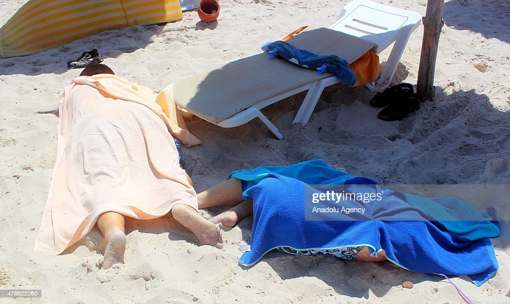 Dead bodies are seen after an armed attack on a tourist hotel in Sousse, east Tunisia, left at least 27 people dead, including foreigners, and injured six others , on June 26, 2015.