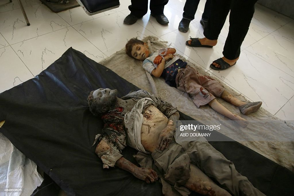 Dead Bodies Are Seen On The Floor At A Make Shift Hospital In The  Rebel Held Area Of Douma, East Of The Capital Damascus, Following Shelling  And Air Raids ...
