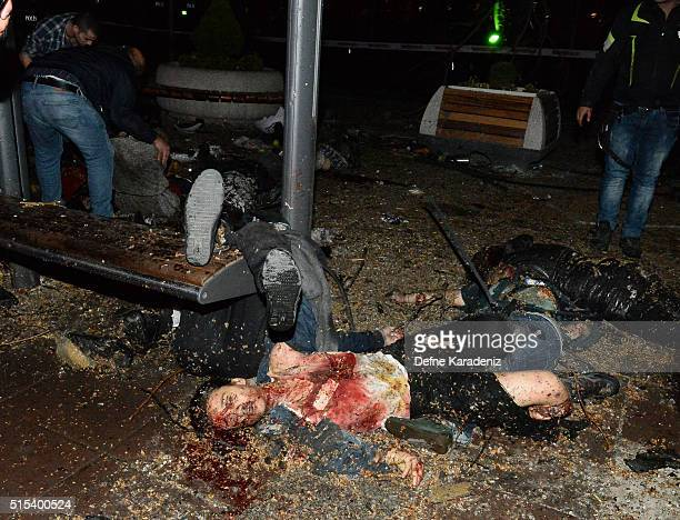 Dead bodies lay in the street after an explosion in Ankara's central Kizilay district on March 13 2016 in Ankara Turkey The Ankara governor's office...