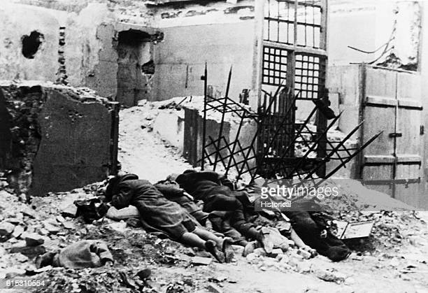 Dead bodies lie face down in the rubble of the Warsaw Ghetto