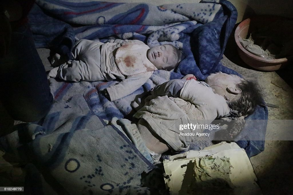 Dead bodies of 3-month-old baby Hamza Abdullah (L) and his 6-year-old sister Hamsa Abdullah are seen after the Russian airstrikes targeted residential areas in opposition controlled Katranci neighborhood of Aleppo, Syria on February 14, 2016.